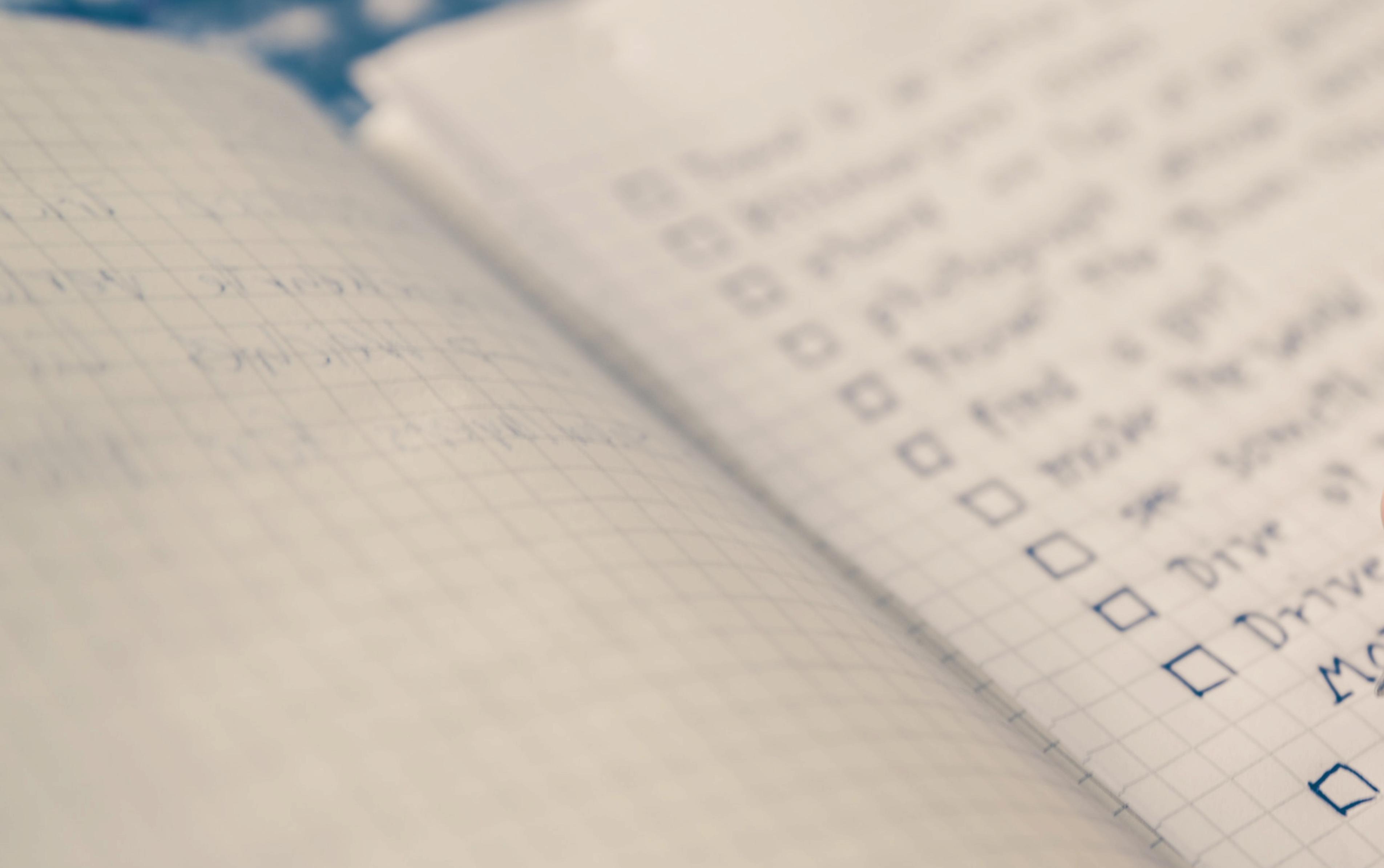 A notebook with handwritten checklist.