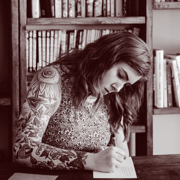 Writer in library writing